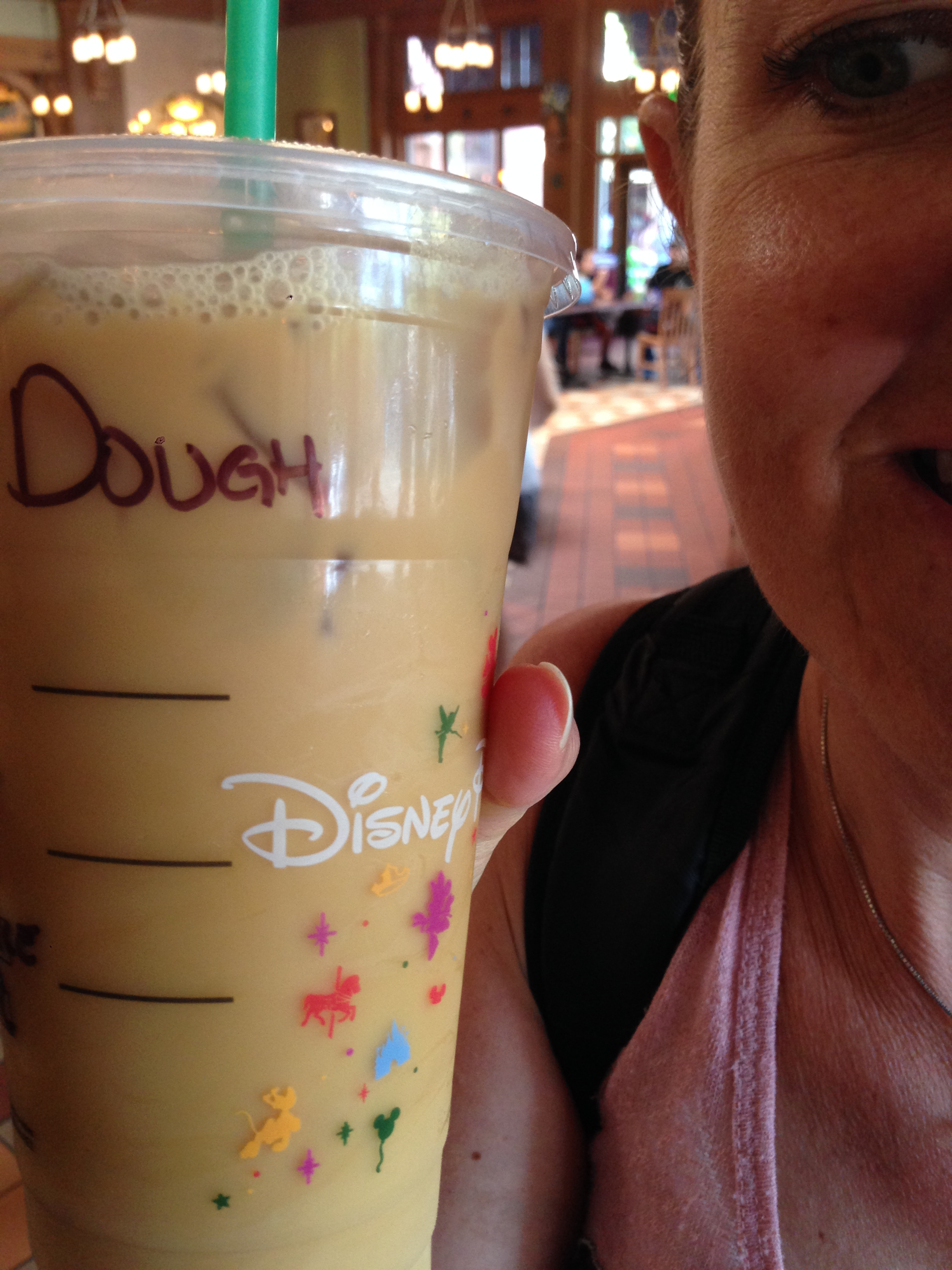 There is a Starbucks in both Disneyland and California Adventure!!!